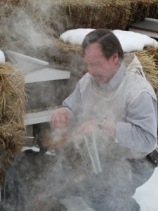 The smoker has bellows to push the smoke out.  The smoke helps to make the bees docile.