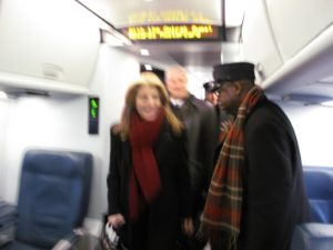 A blur of Caroline Kennedy and her husband, Edwin Schlossberg, in motion finding their seats.