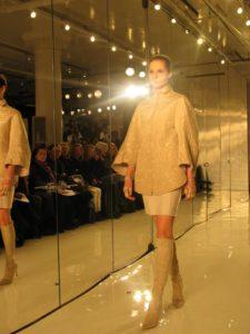 An elegant beige wool and taffeta dress