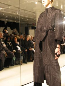An elegant coat of black moire and cashmere