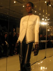 A white cashmere jacket and black leather jeans