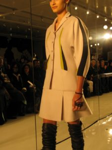 An ivory cashmere suit with slices of chartreuse and black