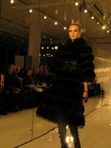 A black sable and broadtail coat