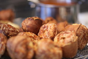The popovers were baked with a sprinkling of grated gruyere cheese.