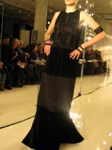 A black broadtail, silk crepe, and velvet gown