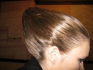 A closeup of the model hairdo