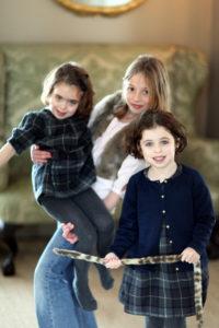 Darcy's daughters Ella Bea (held by Yasmin) and Daisy
