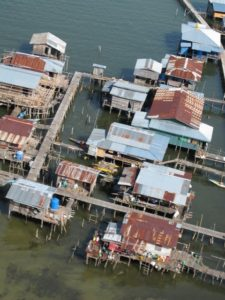 Along the way, we flew over many villages built upon stilts over the sea.