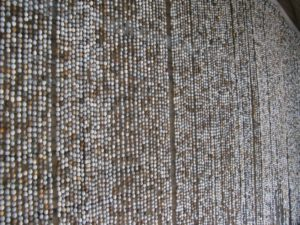 A curtain of seed beads - very rustic and African