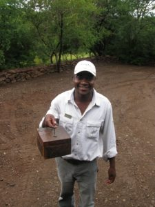 The little box Thembe Mabunda is carrying contained liquor for the guests.