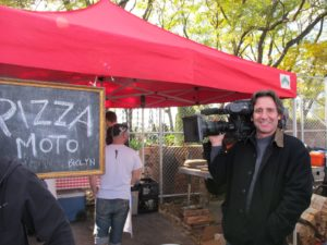 Gary standing in front of Pizza Moto www.pizzamotobklyn.com - a portable wood oven pizza parlor