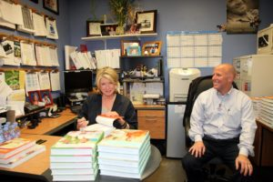 Here I am with Tom Daly, the manager of the Norwalk Costco and I presigned a stack of books for employees of the store.