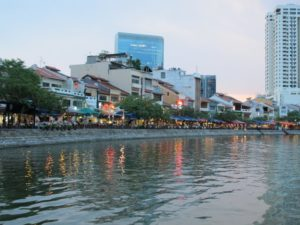 There are many busy restaurants along the river's edge.