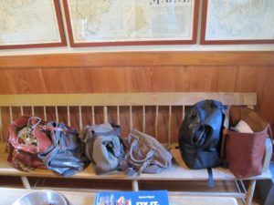 The bench in the map room was designated for everyone's day bags.