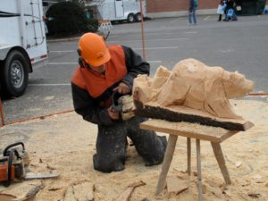 Here he is at work carving a bear.
