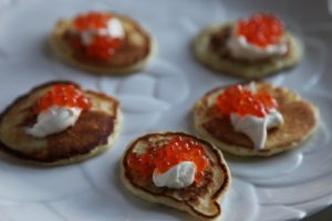 Blini with sour cream and caviar