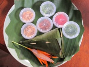 We also tried this wonderful lunch dish.  The banana leaf is filled with rice seasoned with seafood and spices.  When opened, you eat it with an assortment of toppings.