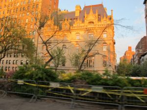 A glimpse onto East 94th Street from inside Central Park - the barricades mark the site where, due to the excessive rain and snowfall in the past six months, a tree recently came down.