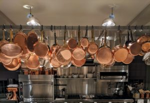 Here's a wider view of the pot rack all filled with copper. Copper was actually one of the first metals used by humans more than 10-thousand years ago, and it remains a common household material today. Polishing copper, silver, brass or any other metal three or four times a year is generally sufficient to keep it in good condition.