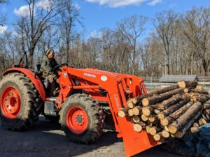 Using our trusted Kubota model M7060HD12 tractor, Chhiring hauls all the cut pieces to the woodpile where they will be saved for another project or chipped for top dressing in the woods.
