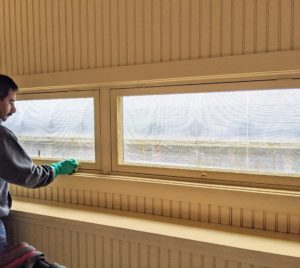Here, Carlos cleans the windows and trim work - making sure latches and other handles are given special attention.