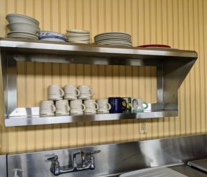 All the cups and plates are washed and placed back on the shelves.