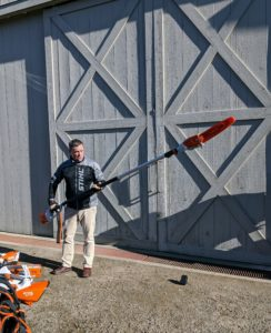 Brian shows us how light the pole pruner is and how easy it is to maneuver.