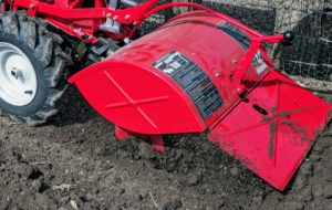 Here, one can see the forward-rotating tines. This model has an adjustable tilling depth up to seven inches.