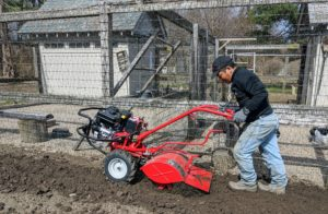 Rototilling is one method of turning up the soil before planting the garden. Regular tilling over time can improve soil structure.