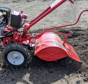 On rear-tine tillers like this, wheels are standard operating equipment. This has a 20-inch tilling width and a 12-inch tine diameter.
