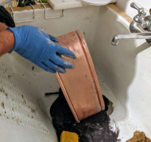 Carlos uses the same easy steps to clean this vessel - rubbing a generous amount of Wright's Cream over the entire copper cachepot.