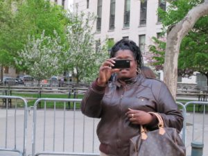 Kim now has her camera out and is clicking away.