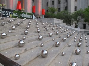 The stairs leading into the party were decorated with many, many silver balls and votive candles.