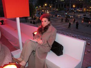 Cindy Adams - celebrity gossip columnist sat outside, where it was quite chilly.