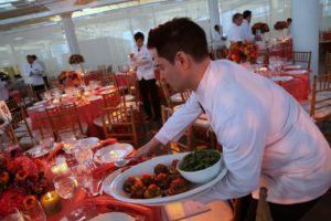 Serving the first course of a vegetable timbale