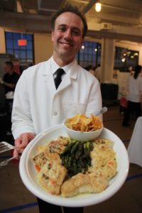 Roasted halibut provencale with capers, lemon, and fennel served with grilled asparagus and pommes gaufrettes