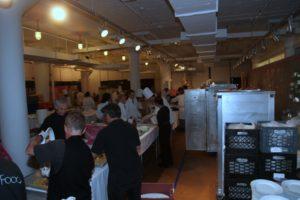 A bustling makeshift kitchen area at Starrett