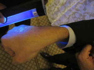 The hand of each attendee was marked with a black light-sensitive stamp.