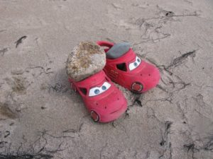 A child was playing with these little trucks - or are they shoes?