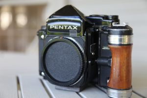 One of his well-used cameras that he takes on his world travels.