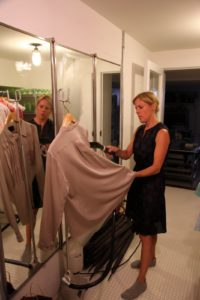 In the basement, Annie, my wardrobe stylist, is steaming a blouse.