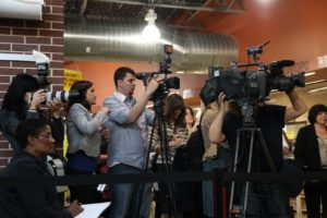 The local press was lined up.