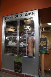 The meat department offers dry-aged beef.