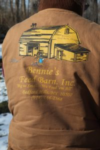 """The logo on the back of his vest - """"Big to Small - We Feed 'em All"""""""