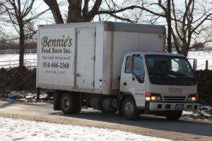 Bennie's truck arrived at the farm to make a delivery.