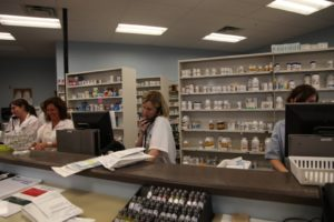 A very busy pharmacy with a drive-up window