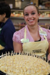 Anina - Cheese Team Leader - offered samples of cheese.