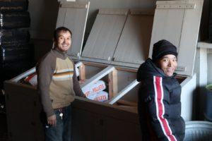 Chhiring and Gelbu loading up the storage bins