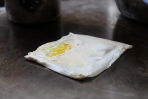 The little roti canai pocket is then cooked on a griddle.