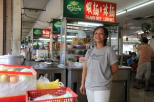 The hawker's center has many different vendors of Chinese food.
